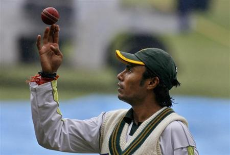Pakistan's Danish Kaneria spins a ball during a cricket training session in Bangalore, December 7, 2007. REUTERS/Adnan Abidi/Files