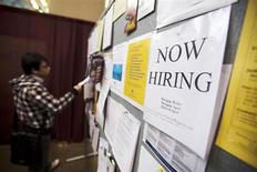A man looks at a job board posted at a job fair in Toronto in this April 1, 2009 file photo. REUTERS/Mark Blinch