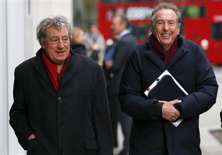 Monty Python members Eric Idle (R) and Terry Jones return to the High Court after a lunch break in central London December 4, 2012. REUTERS/Andrew Winning