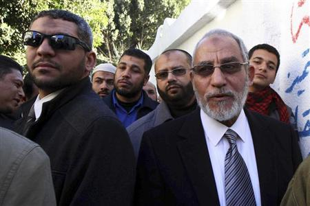 Mohamed Badie (R), the leader of the Muslim Brotherhood, queues outside a polling centre to vote in the final stage of a referendum on Egypt's new constitution in Bani Sweif, about 115 km (71 miles) south of Cairo December 22, 2012. REUTERS/Stringer