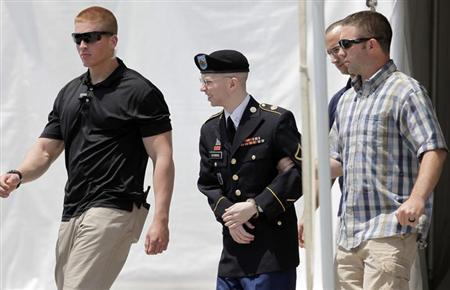 U.S. Army Private First Class Bradley Manning (C) is escorted from the courtroom after a day of his court martial trial at Fort Meade, Maryland June 25, 2013. REUTERS/Yuri Gripas