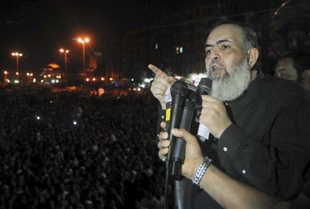 Egypt's Salafi leader and former presidential candidate Hazem Salah Abu Ismail speaks to his supporters and supporters of Islamist President Mohamed Mursi at Tahrir Square in Cairo July 13, 2012. REUTERS/Mohamed Abd El-Ghany
