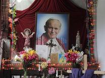 An altar of Pope John Paul II is pictured in the house of Floribeth Mora, the Costa Rican woman whose inexplicable curing of her medical condition has been attributed to a miracle by John Paul, in Cartago July 4, 2013. REUTERS/Juan Carlos Ulate