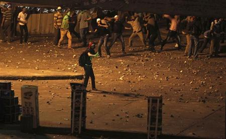 Members of the Muslim Brotherhood and supporters of ousted Egyptian President Mohamed Mursi clash and throw stones at anti-Mursi protesters near Maspero, Egypt's state TV and radio station, near Tahrir square in Cairo July 5, 2013. REUTERS/Amr Abdallah Dalsh