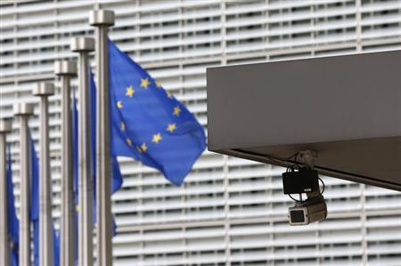 A security camera is seen at the main entrance of the European Union Commission headquarters in Brussels July 1, 2013. REUTERS/Francois Lenoir