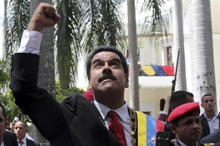 Venezuela's President Nicolas Maduro greets supporters as he arrives for a national assembly in Caracas to attend an Independence day ceremony in this July 5, 2013 handout from Miraflores Palace. REUTERS/Miraflores Palace/Handout via Reuters