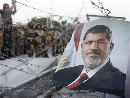 A portrait of former Egyptian President Mohamed Mursi is seen near a Republican Guard building in Cairo July 5, 2013. REUTERS/Asmaa Waguih