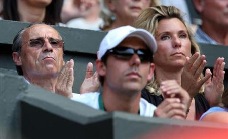 The father of Marion Bartoli of France, Walter (L), sits on Centre Court for the women's singles final tennis match between Bartoli and Sabine Lisicki of Germany at the Wimbledon Tennis Championships, in London July 6, 2013. REUTERS/Suzanne Plunkett