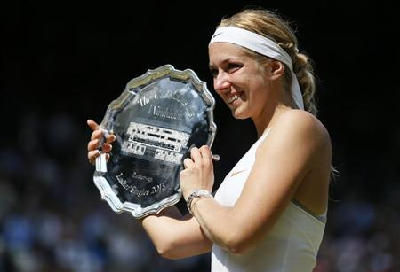 Sabine Lisicki of Germany holds her runners-up trophy after being defeated by Marion Bartoli of France in their women's singles final tennis match at the Wimbledon Tennis Championships, in London July 6, 2013. REUTERS/Stefan Wermuth