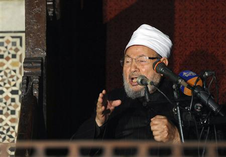 Egyptian Cleric Sheikh Yusuf al-Qaradawi, chairman of the International Union of Muslim Scholars, gives a speech during Friday prayers, before a protest against Syrian President Bashar al-Assad, at Al Azhar mosque in old Cairo December 28, 2012. REUTERS/Amr Abdallah Dalsh