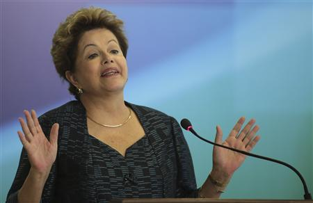 Brazil's President Dilma Rousseff speaks during an announcement of the construction of the first 50 port terminals for private use (TUP), at the Planalto Palace in Brasilia July 3, 2013. REUTERS/Ueslei Marcelino (BRAZIL - Tags: POLITICS MARITIME BUSINESS) - RTX11BE4