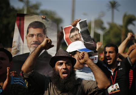 Supporters of deposed Egyptian President Mohamed Mursi shout slogans during a protest near Cairo University in Cairo July 6, 2013. REUTERS/Suhaib Salem (EGYPT - Tags: POLITICS CIVIL UNREST)