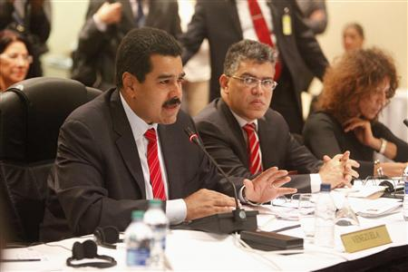 Venezuelan President Nicholas Maduro addresses members of CARICOM at a plenary session during the 40th Heads of government meeting at the Hilton Trinidad and Conference Centre July 6, 2013. REUTERS/Andrea De Silva (TRINIDAD AND TOBAGO - Tags: POLITICS)