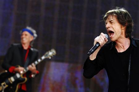 Mick Jagger (R) and Keith Richards of the Rolling Stones perform at the British Summer Time Festival in Hyde Park in London July 6, 2013. REUTERS/Luke MacGregor