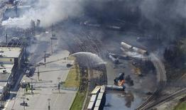 The wreckage of a train is pictured after an explosion in Lac Megantic July 6, 2013. REUTERS/Mathieu Belanger