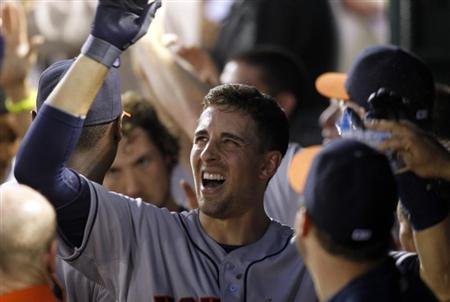 Houston Astros Jason Castro is congratulated by teammates after hitting a three-run home run against the Texas Rangers in the seventh inning of their MLB American League baseball game in Arlington, Texas July 6, 2013. REUTERS/Mike Stone