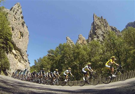 The pack of riders cycles on its way past the Gorges de Saint-Georges during the 195 km eighth stage of the centenary Tour de France cycling race from Castres to Ax 3 Domaines July 6, 2013. REUTERS/Jacky Naegelen