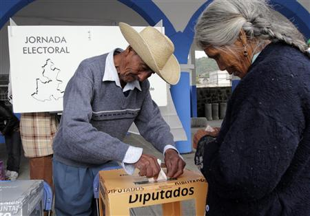 People cast their votes in a ballot box reading ''Delegates'' in Santiago Xalitzintla July 7, 2013. REUTERS/Imelda Medina