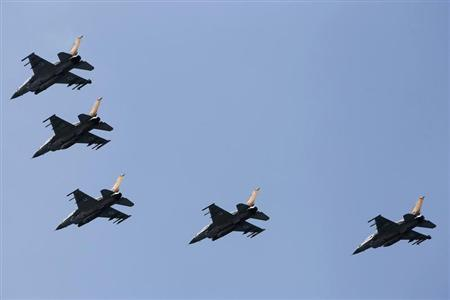 Israeli Air Force F-16 war planes fly in formation over the Mediterranean Sea as part of celebrations for Israel's Independence Day, marking the 65th anniversary of the creation of the state, April 16, 2013. REUTERS/Amir Cohen