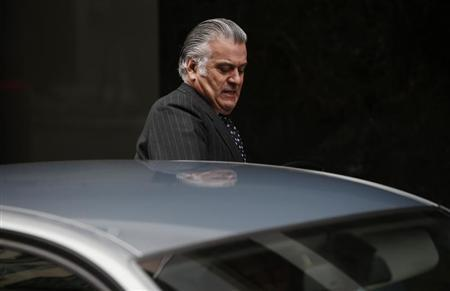 Former People's Party treasurer Luis Barcenas enters a car as he leaves Spain's High Court after appearing before a judge in Madrid, March 22, 2013. REUTERS/Susana Vera