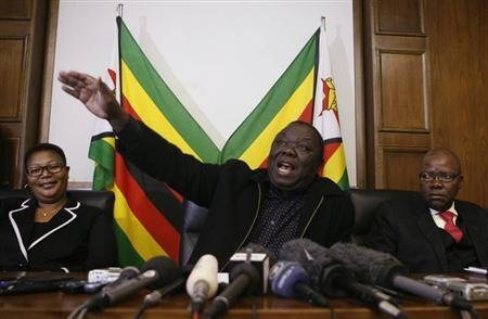 Zimbabwe Prime Minister and leader of the opposition Movement for Democratic Change (MDC) Morgan Tsvangirai gestures during a news conference in Harare, June 13, 2013. REUTERS/Philimon Bulawayo