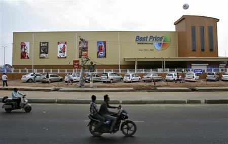 Two-wheelers move past the newly opened Bharti Wal-Mart Best Price Modern wholesale store in the southern Indian city of Hyderabad September 26, 2012. Picture taken September 26, 2012. To match Analysis WALMART-INDIA-SUPPLIERS REUTERS/Krishnendu Halder