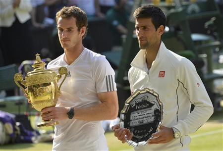 Andy Murray of Britain (L) holds the winners trophy, with Novak Djokovic of Serbia holding the runners-up trophy, after defeating him in their men's singles final tennis match at the Wimbledon Tennis Championships, in London July 7, 2013. REUTERS/Toby Melville