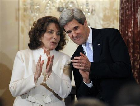 John Kerry is pictured with his wife Teresa Heinz-Kerry after being sworn-in as U.S. Secretary of State by U.S. Vice President Joe Biden (not pictured) during a ceremony at the State Department in Washington, February 6, 2013. REUTERS/Jason Reed