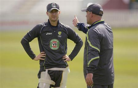 Australia's captain Michael Clarke (L) listens to coach Darren Lehmann during a training session before Wednesday's cricket match against Somerset at the County ground in Taunton, Somerset June 25, 2013. REUTERS/Philip Brown