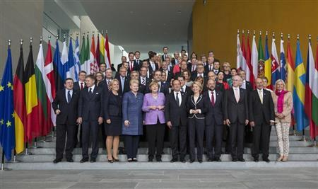 German Chancellor Angela Merkel (first row 5th L), France's President Francois Hollande (first row 6th R), Lithuania's President Dalia Grybauskaite (first row 8th R), European Commission President Jose Manuel Barroso (first row L), European Parliament President Martin Schulz (first row 4th R), European Council President Herman Van Rompuy (1st row 3rd R) and European officials pose for a family picture at an EU conference on Youth Unemployment in Berlin, July 3, 2013. REUTERS/Thomas Peter