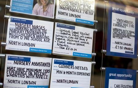 Job adverts are seen placed in the window of a recruitment agency in London February 20, 2013. REUTERS/Neil Hall