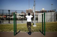 A man works out in an outdoor exercise area at Macombs Dam Park in the Bronx section of New York City, September 13, 2012. REUTERS/Mike Segar