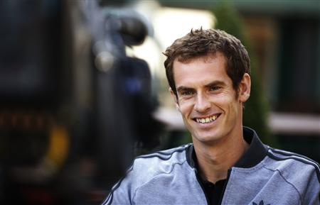 Tennis player Andy Murray of Britain is interviewed for a breakfast television program the morning after he winning the men's singles title at the Wimbledon Tennis Championships, Wimbledon, southwest London July 8, 2013. REUTERS/Chris Helgren