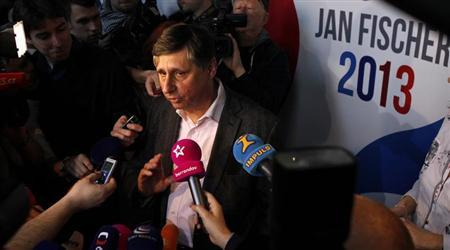 Czech presidential candidate Jan Fischer answers questions from the media after the polling stations closed for the country's first ever direct presidential election, to replace outgoing president Vaclav Klaus, in Prague January 12, 2013. REUTERS/David W Cerny
