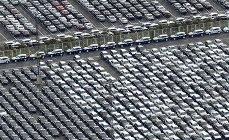 Cars for export stand in a parking area at a shipping terminal in the harbour of the northern German town of Bremerhaven, late October 8, 2012. REUTERS/Fabian Bimmer
