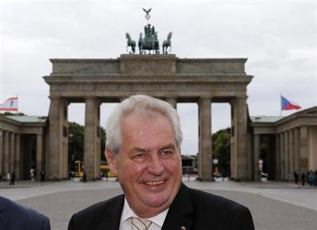 Czech Republic President Milos Zeman smiles as he visit the Brandenburg Gate in Berlin June 26, 2013. REUTERS/Fabrizio Bensch