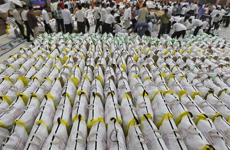 Volunteers pack relief supplies to be sent to Uttarakhand, inside a temple in Ahmedabad July 6, 2013. REUTERS/Amit Dave