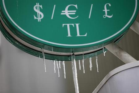 Turkish Lira (TL) and international currency symbols are seen over an ATM machine of a bank in central Istanbul February 1, 2012. REUTERS/Murad Sezer/Files