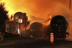 First responders fight burning trains after a train derailment and explosion in Lac-Megantic, Quebec early July 6, 2013 in this picture provided by the Transportation Safety Board of Canada. REUTERS/Transportation Safety Board of Canada/Handout via Reuters