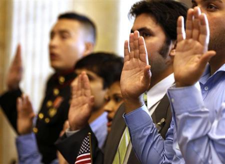 Candidates swear in as United States citizens during a Special Naturalization Ceremony for 30 U.S. citizen candidates in the Cash Room at the U.S. Treasury Department in Washington, July 3, 2013. REUTERS/Larry Downing