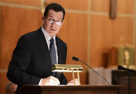Dannel Malloy, Governor of Connecticut speaks to mourners gathererd inside the St. Rose of Lima Roman Catholic Church at a vigil service for victims of the Sandy Hook Elementary School shooting that left at least 27 people dead - many of them young children - in Newtown, Connecticut, December 14, 2012. REUTERS/Andrew Gombert/Pool
