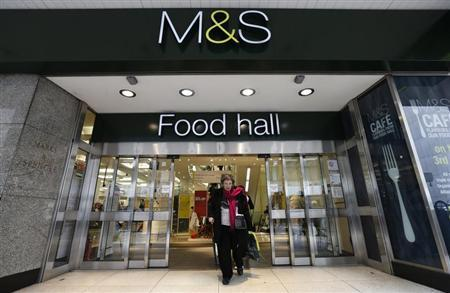 A customer leaves a Marks & Spencer shop in central London May 21, 2013. REUTERS/Suzanne Plunkett
