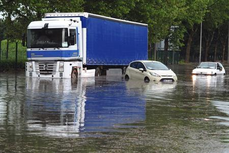 Cars and a lorry are blocked on a street after a heavy thunderstorm with rain caused local flooding in Aulnay sous Bois near Paris, June 19, 2013. REUTERS/Pascal Rossignol