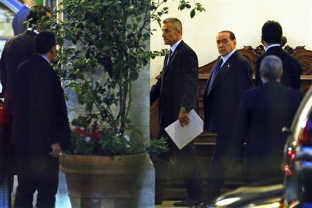 Italy's former Prime Minister Silvio Berlusconi (C) leaves his residence at Grazioli palace, downtown Rome, June 25, 2013. REUTERS/Tony Gentile
