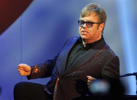 Musician Elton John acknowledges the audience during his performance at the 20th Annual Race to Erase MS benefit gala in Los Angeles May 3, 2013. REUTERS/Fred Prouser