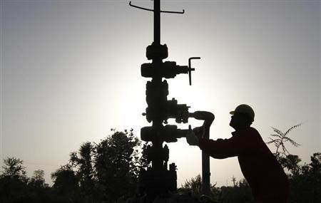 A technician opens a pressure gas valve on the outskirts of Ahmedabad March 2, 2012. REUTERS/Amit Dave/Files
