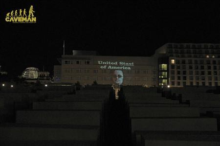 A handout picture shows a projection of text reading 'United Stasi of America' on the building of the U.S. Embassy in Berlin, July 8, 2013. Stasi was a secret police in the former GDR. REUTERS/Lichtkuenstler Oliver Bienkowski, Caveman Guerilla Marketing Agentur GmbH/Handout via Reuters