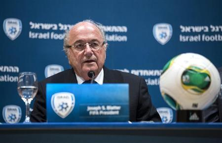 FIFA President Sepp Blatter speaks during a joint news conference with Avi Luzon, Israeli Football Association Chairman (not pictured), in Jerusalem July 9, 2013. REUTER/Baz Ratner