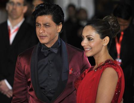 Actor Shah Rukh Khan and his wife Gauri Khan arrive for the inaugural Times of India Film Awards in Vancouver, British Columbia April 6, 2013. REUTERS/Jimmy Jeong/Files