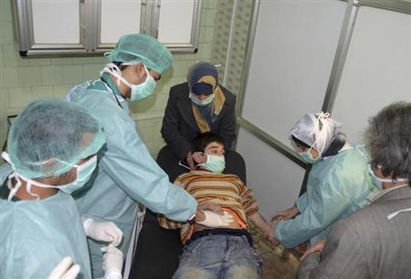 A boy, affected in what the government said was a chemical weapons attack, is treated at a hospital in the Syrian city of Aleppo March 19, 2013. REUTERS/George Ourfalian